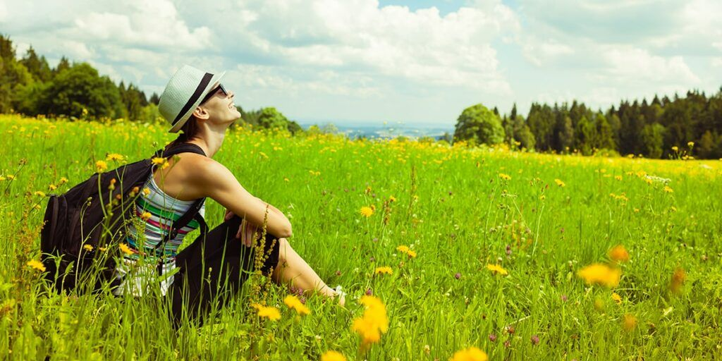 Difference between Hiking and Backpacking - Young Woman Backpacker Enjoying Nature