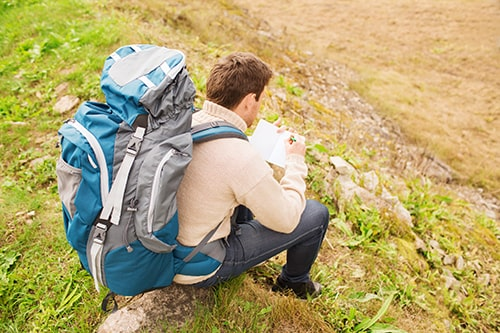 How to Avoid Getting Lost while Hiking - Man with Backpack Taking Notes