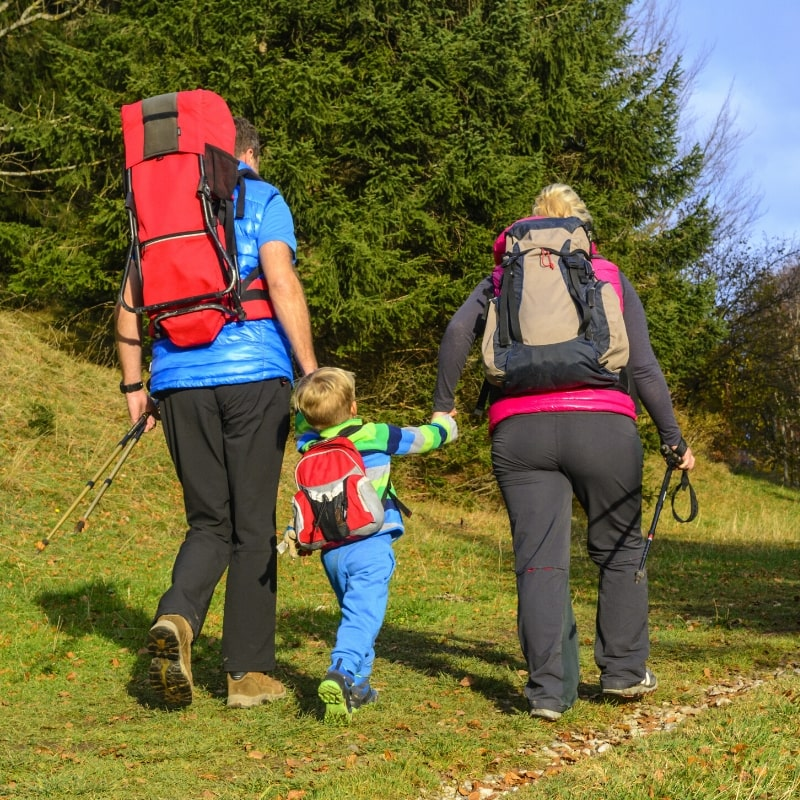 How to Choose a Hiking Backpack - Family Walking on a Trail