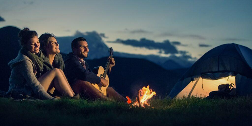 What Is in my Hiking Backpack - Three Friends Camping with Fire on Mountain at Sunset