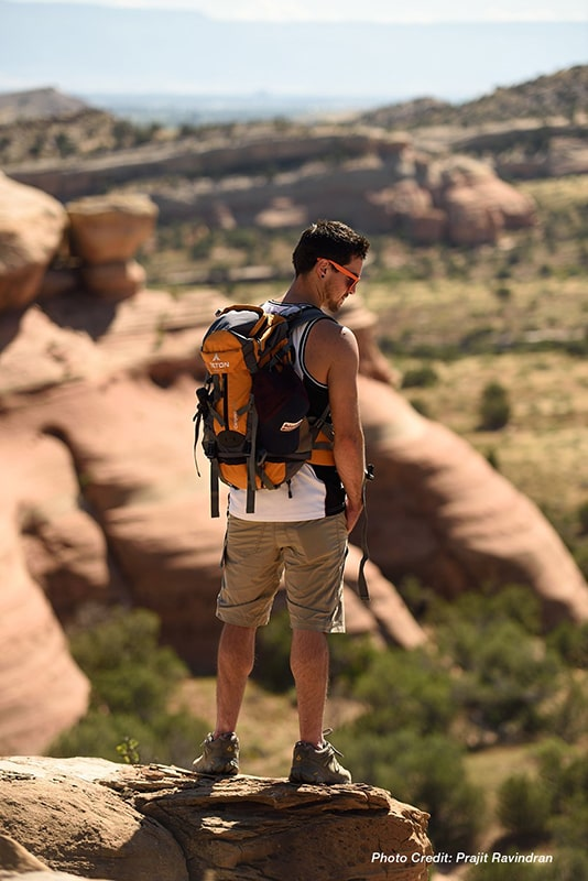 Teton Sports Canyon 2100 Backpack Review - Canyoneer Standing on the Edge of a Cliff