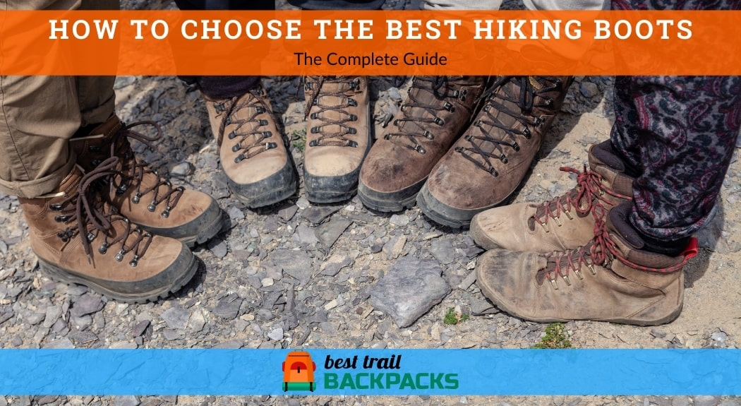 The Best Hiking Boots - Four Tourists in Hiking Boots on Rocky Cliff