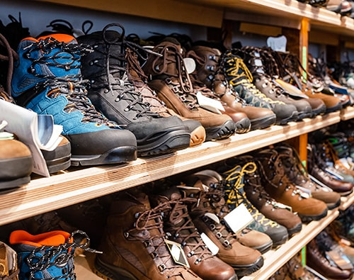 Many Pairs of Hiking, Trekking, and Mountaineering Boots in a Store